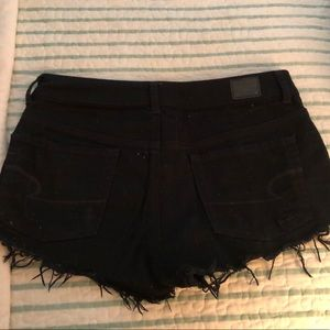High waisted black American eagle jean shorts.